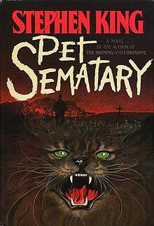 Stephen King Pet Sematary book cover with cat and graveyard
